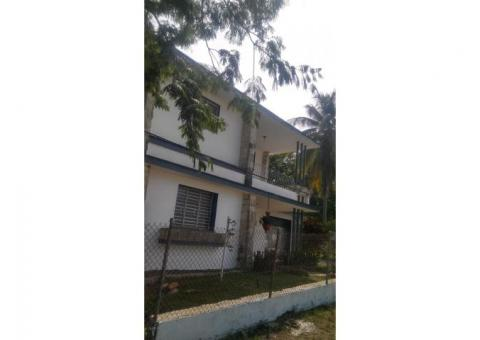 I am selling a house with 2 floors with a total land of 921.38 square meters.